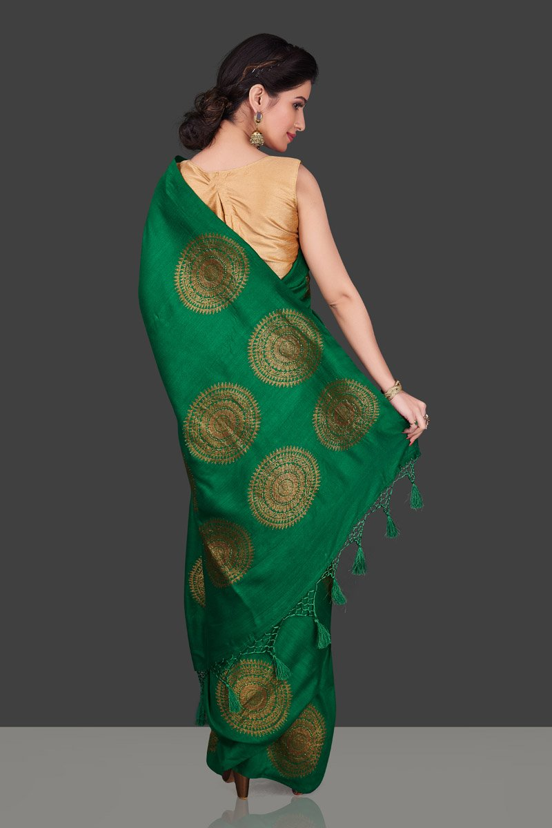 Buy bottle green borderless muga Banarasi sari online in USA with big antique zari buta. Shop beautiful Banarasi sarees, georgette sarees, pure muga silk sarees in USA from Pure Elegance Indian fashion boutique in USA. Get spoiled for choices with a splendid variety of Indian saris to choose from! Shop now.-back