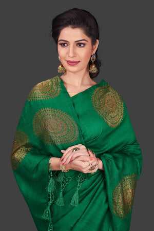 Buy bottle green borderless muga Banarasi sari online in USA with big antique zari buta. Shop beautiful Banarasi sarees, georgette sarees, pure muga silk sarees in USA from Pure Elegance Indian fashion boutique in USA. Get spoiled for choices with a splendid variety of Indian saris to choose from! Shop now.-closeup