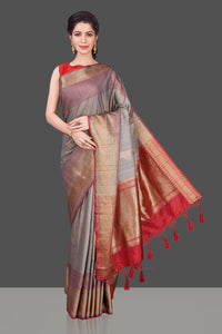 Shop beautiful grey tussar Banarasi saree online in USA with red zari border. Shop beautiful Banarasi sarees, tussar sarees, pure muga silk sarees in USA from Pure Elegance Indian fashion boutique in USA. Get spoiled for choices with a splendid variety of Indian saris to choose from! Shop now.-full view