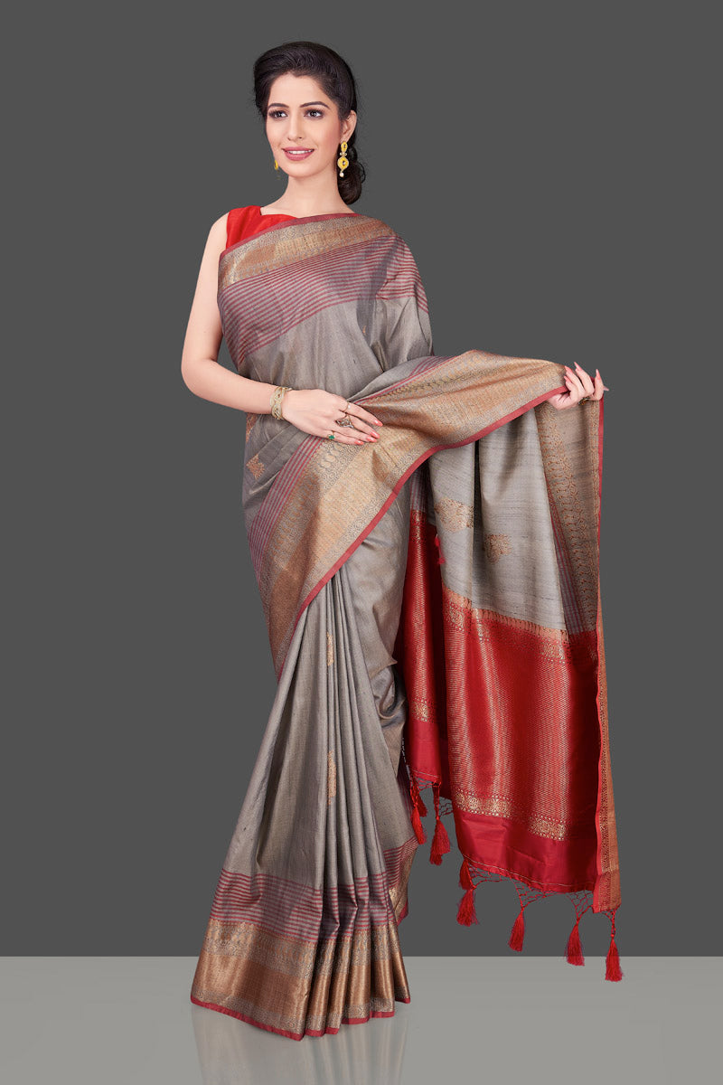 Shop beautiful grey tussar Banarasi saree online in USA with red zari border. Shop beautiful Banarasi sarees, tussar sarees, pure muga silk sarees in USA from Pure Elegance Indian fashion boutique in USA. Get spoiled for choices with a splendid variety of Indian saris to choose from! Shop now.-front