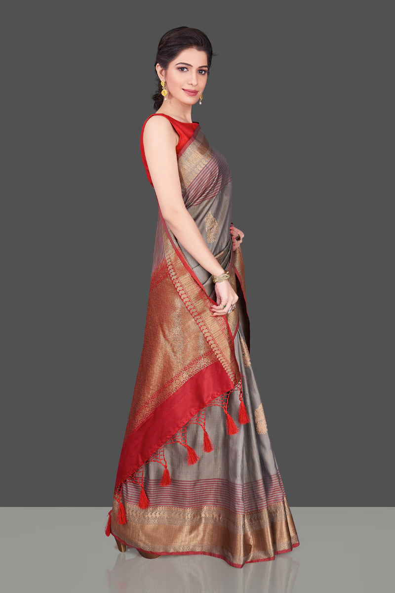 Shop beautiful grey tussar Banarasi saree online in USA with red zari border. Shop beautiful Banarasi sarees, tussar sarees, pure muga silk sarees in USA from Pure Elegance Indian fashion boutique in USA. Get spoiled for choices with a splendid variety of Indian saris to choose from! Shop now.-side
