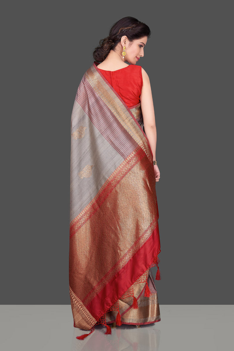 Shop beautiful grey tussar Banarasi saree online in USA with red zari border. Shop beautiful Banarasi sarees, tussar sarees, pure muga silk sarees in USA from Pure Elegance Indian fashion boutique in USA. Get spoiled for choices with a splendid variety of Indian saris to choose from! Shop now.-back