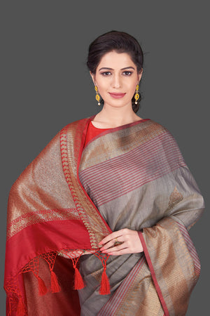 Shop beautiful grey tussar Banarasi saree online in USA with red zari border. Shop beautiful Banarasi sarees, tussar sarees, pure muga silk sarees in USA from Pure Elegance Indian fashion boutique in USA. Get spoiled for choices with a splendid variety of Indian saris to choose from! Shop now.-details