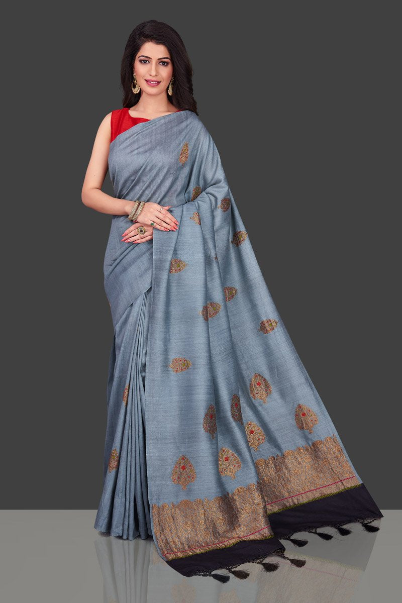 Buy light grey borderless muga Banarasi saree online in USA with floral zari buta. Shop beautiful Banarasi sarees, georgette sarees, pure muga silk sarees in USA from Pure Elegance Indian fashion boutique in USA. Get spoiled for choices with a splendid variety of designer saris to choose from! Shop now.-full view