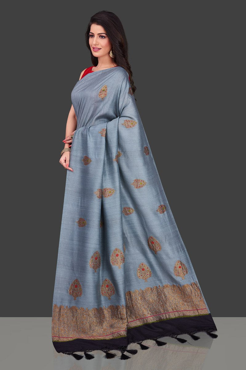 Buy light grey borderless muga Banarasi saree online in USA with floral zari buta. Shop beautiful Banarasi sarees, georgette sarees, pure muga silk sarees in USA from Pure Elegance Indian fashion boutique in USA. Get spoiled for choices with a splendid variety of designer saris to choose from! Shop now.-side