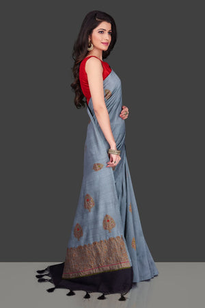Buy light grey borderless muga Banarasi saree online in USA with floral zari buta. Shop beautiful Banarasi sarees, georgette sarees, pure muga silk sarees in USA from Pure Elegance Indian fashion boutique in USA. Get spoiled for choices with a splendid variety of designer saris to choose from! Shop now.-rightside