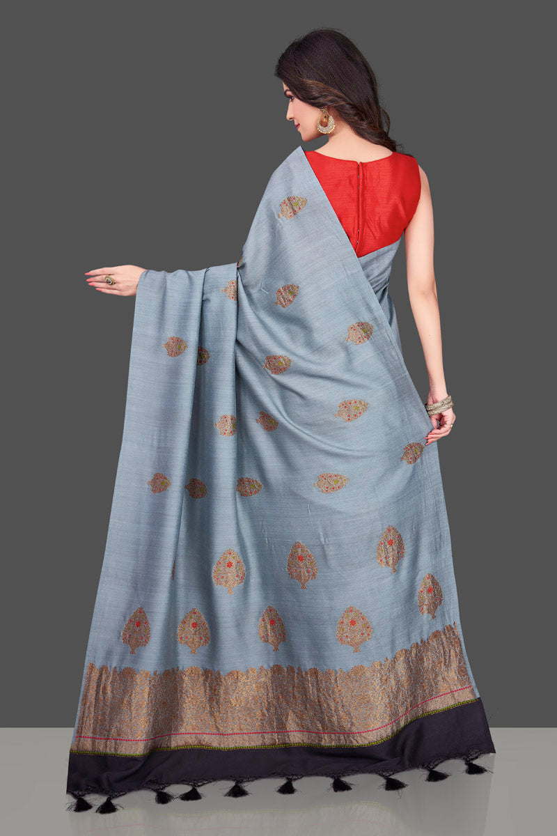 Buy light grey borderless muga Banarasi saree online in USA with floral zari buta. Shop beautiful Banarasi sarees, georgette sarees, pure muga silk sarees in USA from Pure Elegance Indian fashion boutique in USA. Get spoiled for choices with a splendid variety of designer saris to choose from! Shop now.-back