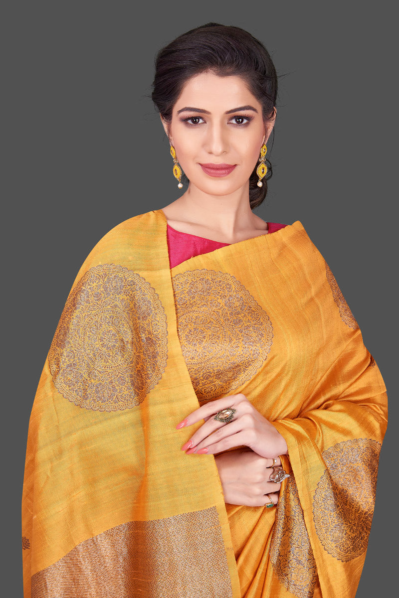 Buy online yellow borderless Banarasi muga saree in USA with big zari buta. Shop beautiful Banarasi sarees, georgette sarees, pure muga silk sarees in USA from Pure Elegance Indian fashion boutique in USA. Get spoiled for choices with a splendid variety of designer saris to choose from! Shop now.-closeup