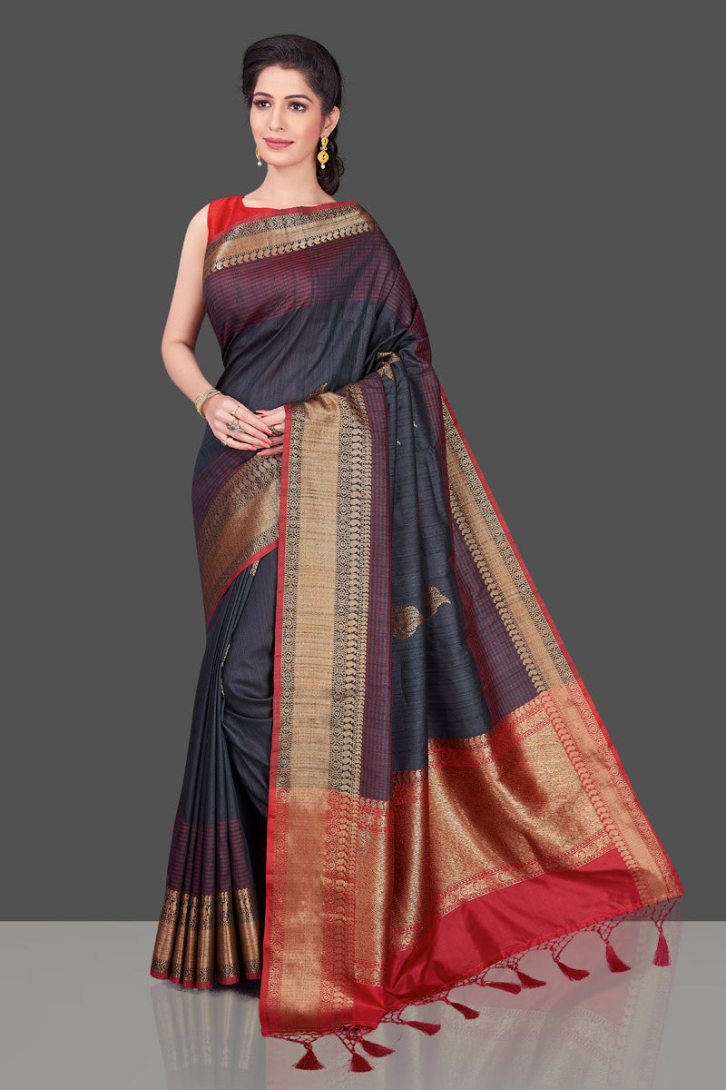 Buy dark grey tussar Banarasi saree online in USA with red zari border. Shop beautiful Banarasi georgette sarees, tussar sarees, pure muga silk sarees in USA from Pure Elegance Indian fashion boutique in USA. Get spoiled for choices with a splendid variety of Indian saris to choose from! Shop now.-front