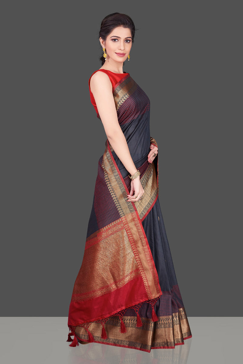 Buy dark grey tussar Banarasi saree online in USA with red zari border. Shop beautiful Banarasi georgette sarees, tussar sarees, pure muga silk sarees in USA from Pure Elegance Indian fashion boutique in USA. Get spoiled for choices with a splendid variety of Indian saris to choose from! Shop now.-side