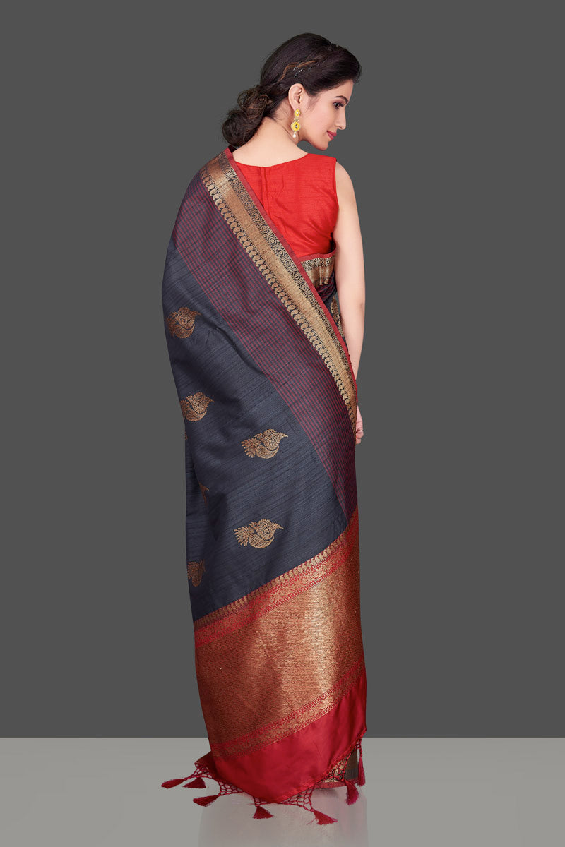 Buy dark grey tussar Banarasi saree online in USA with red zari border. Shop beautiful Banarasi georgette sarees, tussar sarees, pure muga silk sarees in USA from Pure Elegance Indian fashion boutique in USA. Get spoiled for choices with a splendid variety of Indian saris to choose from! Shop now.-back