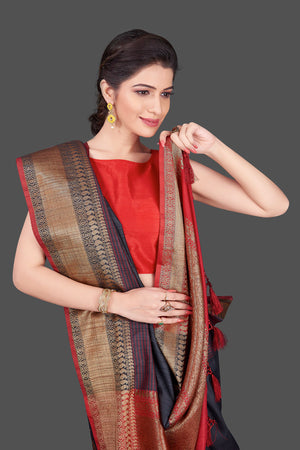 Buy dark grey tussar Banarasi saree online in USA with red zari border. Shop beautiful Banarasi georgette sarees, tussar sarees, pure muga silk sarees in USA from Pure Elegance Indian fashion boutique in USA. Get spoiled for choices with a splendid variety of Indian saris to choose from! Shop now.-closeup