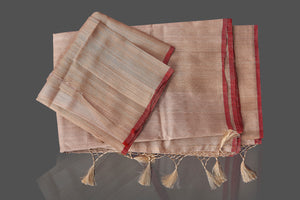 Buy beige tussar Banarasi saree online in USA with floral weave borderl. Shop beautiful Banarasi georgette sarees, tussar sarees, pure muga silk sarees in USA from Pure Elegance Indian fashion boutique in USA. Get spoiled for choices with a splendid variety of Indian saris to choose from! Shop now.-details