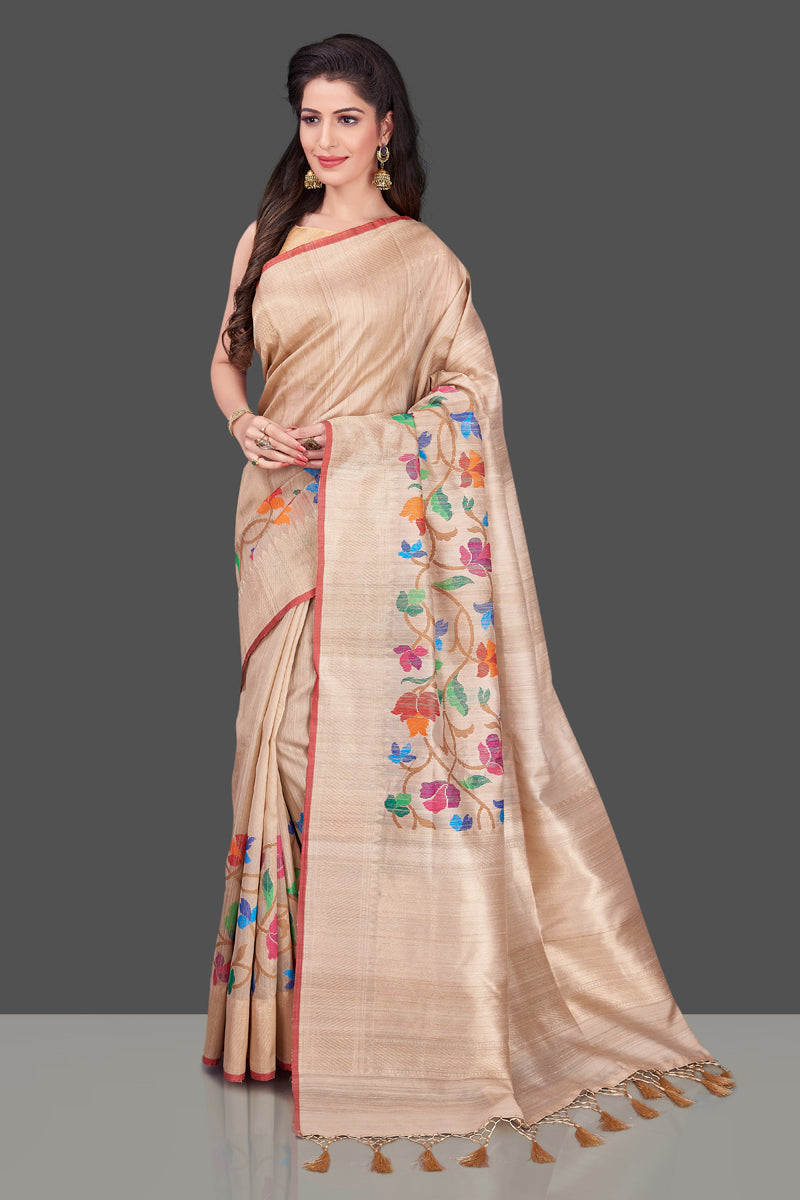 Buy beige tussar Banarasi saree online in USA with floral weave borderl. Shop beautiful Banarasi georgette sarees, tussar sarees, pure muga silk sarees in USA from Pure Elegance Indian fashion boutique in USA. Get spoiled for choices with a splendid variety of Indian saris to choose from! Shop now.-full view