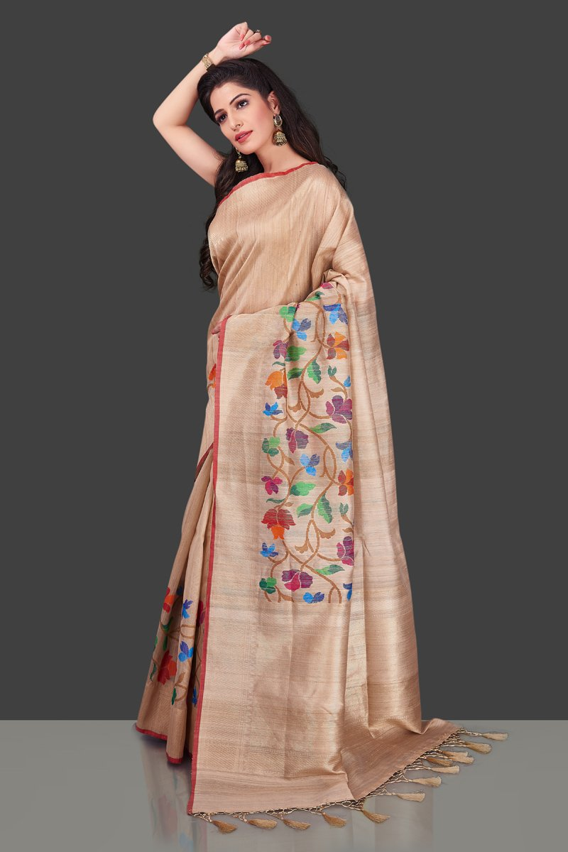 Buy beige tussar Banarasi saree online in USA with floral weave borderl. Shop beautiful Banarasi georgette sarees, tussar sarees, pure muga silk sarees in USA from Pure Elegance Indian fashion boutique in USA. Get spoiled for choices with a splendid variety of Indian saris to choose from! Shop now.-side