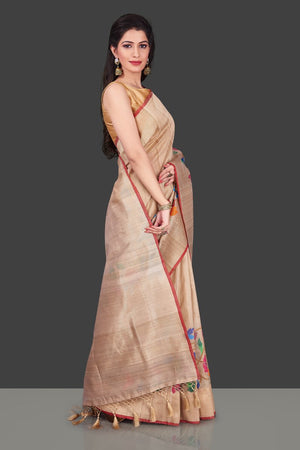 Buy beige tussar Banarasi saree online in USA with floral weave borderl. Shop beautiful Banarasi georgette sarees, tussar sarees, pure muga silk sarees in USA from Pure Elegance Indian fashion boutique in USA. Get spoiled for choices with a splendid variety of Indian saris to choose from! Shop now.-right side