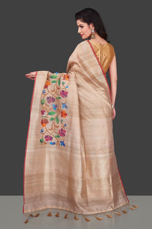 Buy beige tussar Banarasi saree online in USA with floral weave borderl. Shop beautiful Banarasi georgette sarees, tussar sarees, pure muga silk sarees in USA from Pure Elegance Indian fashion boutique in USA. Get spoiled for choices with a splendid variety of Indian saris to choose from! Shop now.-back