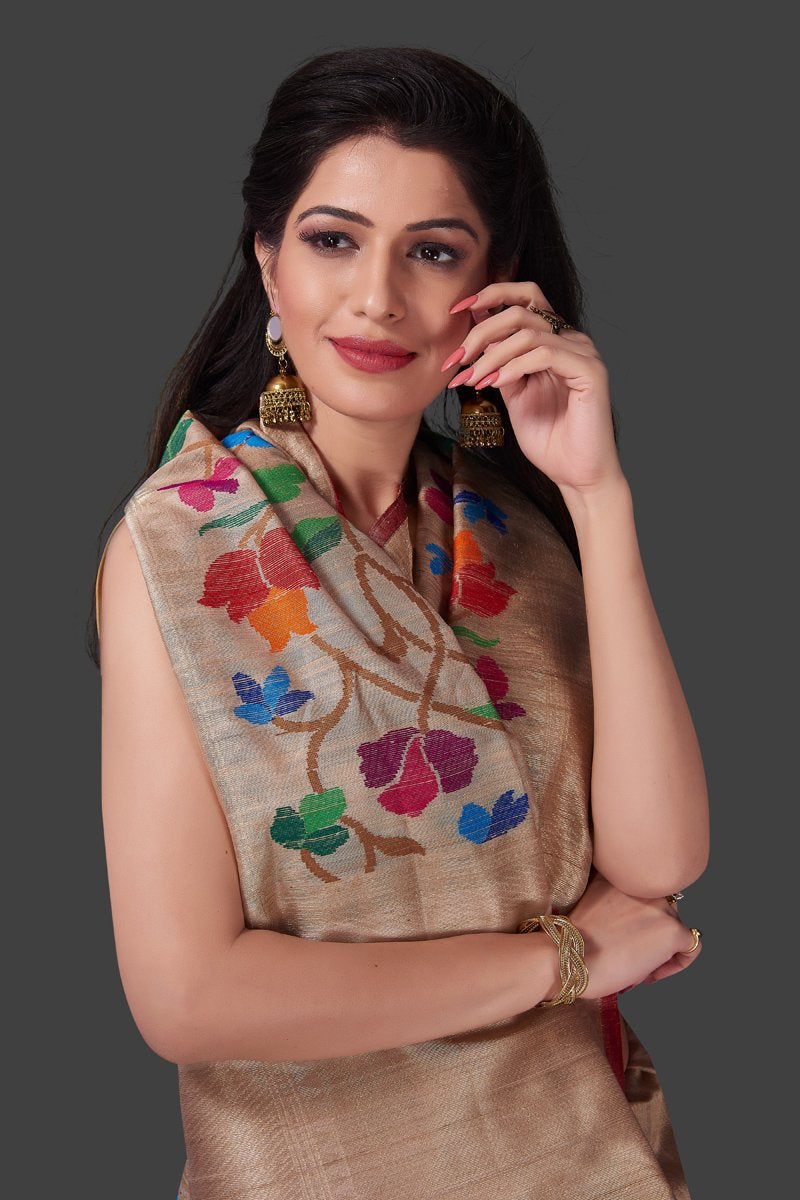 Buy beige tussar Banarasi saree online in USA with floral weave borderl. Shop beautiful Banarasi georgette sarees, tussar sarees, pure muga silk sarees in USA from Pure Elegance Indian fashion boutique in USA. Get spoiled for choices with a splendid variety of Indian saris to choose from! Shop now.-closeup