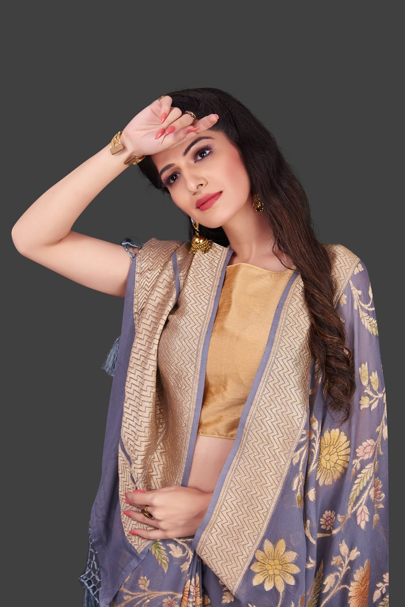 Shop grey georgette Benarasi saree online in USA with floral zari jaal. Shop beautiful Banarasi georgette sarees, tussar sarees, pure muga silk sarees in USA from Pure Elegance Indian fashion boutique in USA. Get spoiled for choices with a splendid variety of Indian sarees to choose from! Shop now.-closeup