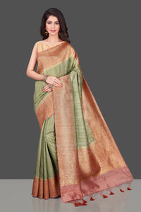 Shop pista green tassar Banarasi saree in USA with pink zari border. Shop beautiful Banarasi georgette sarees, tussar saris, pure muga silk saris in USA from Pure Elegance Indian fashion boutique in USA. Get spoiled for choices with a splendid variety of Indian sarees to choose from! Shop now.-full view