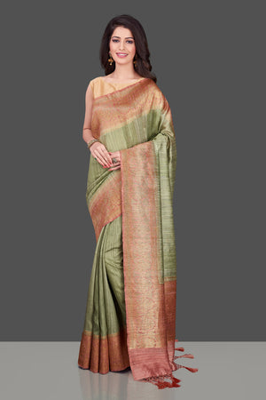 Shop pista green tassar Banarasi saree in USA with pink zari border. Shop beautiful Banarasi georgette sarees, tussar saris, pure muga silk saris in USA from Pure Elegance Indian fashion boutique in USA. Get spoiled for choices with a splendid variety of Indian sarees to choose from! Shop now.-front