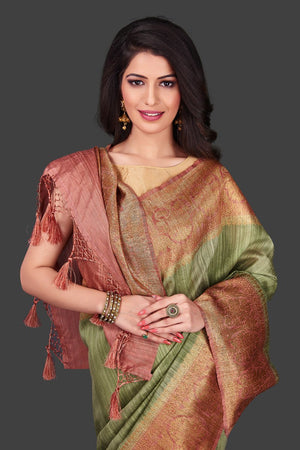 Shop pista green tassar Banarasi saree in USA with pink zari border. Shop beautiful Banarasi georgette sarees, tussar saris, pure muga silk saris in USA from Pure Elegance Indian fashion boutique in USA. Get spoiled for choices with a splendid variety of Indian sarees to choose from! Shop now.-closeup