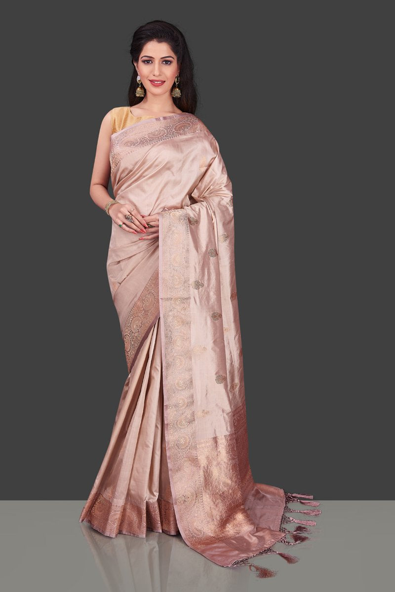 Buy online champagne Banarasi silk saree in USA with zari border and zari buta. Shop beautiful Banarasi georgette sarees, tussar saris, pure muga silk saris in USA from Pure Elegance Indian fashion boutique in USA. Get spoiled for choices with a splendid variety of Indian sarees to choose from! Shop now.-full view