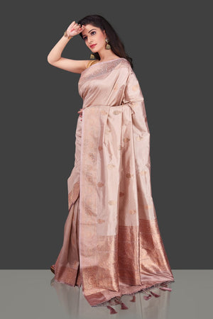 Buy online champagne Banarasi silk saree in USA with zari border and zari buta. Shop beautiful Banarasi georgette sarees, tussar saris, pure muga silk saris in USA from Pure Elegance Indian fashion boutique in USA. Get spoiled for choices with a splendid variety of Indian sarees to choose from! Shop now.-side