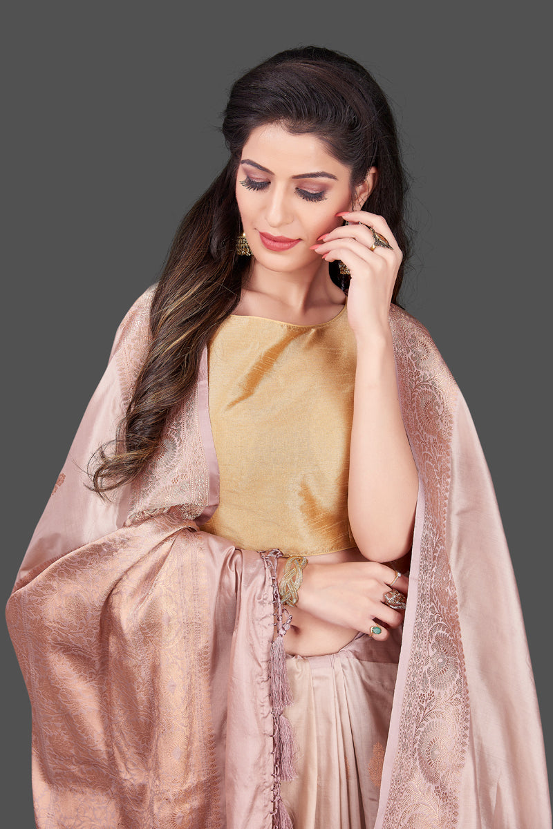 Buy online champagne Banarasi silk saree in USA with zari border and zari buta. Shop beautiful Banarasi georgette sarees, tussar saris, pure muga silk saris in USA from Pure Elegance Indian fashion boutique in USA. Get spoiled for choices with a splendid variety of Indian sarees to choose from! Shop now.-closeup