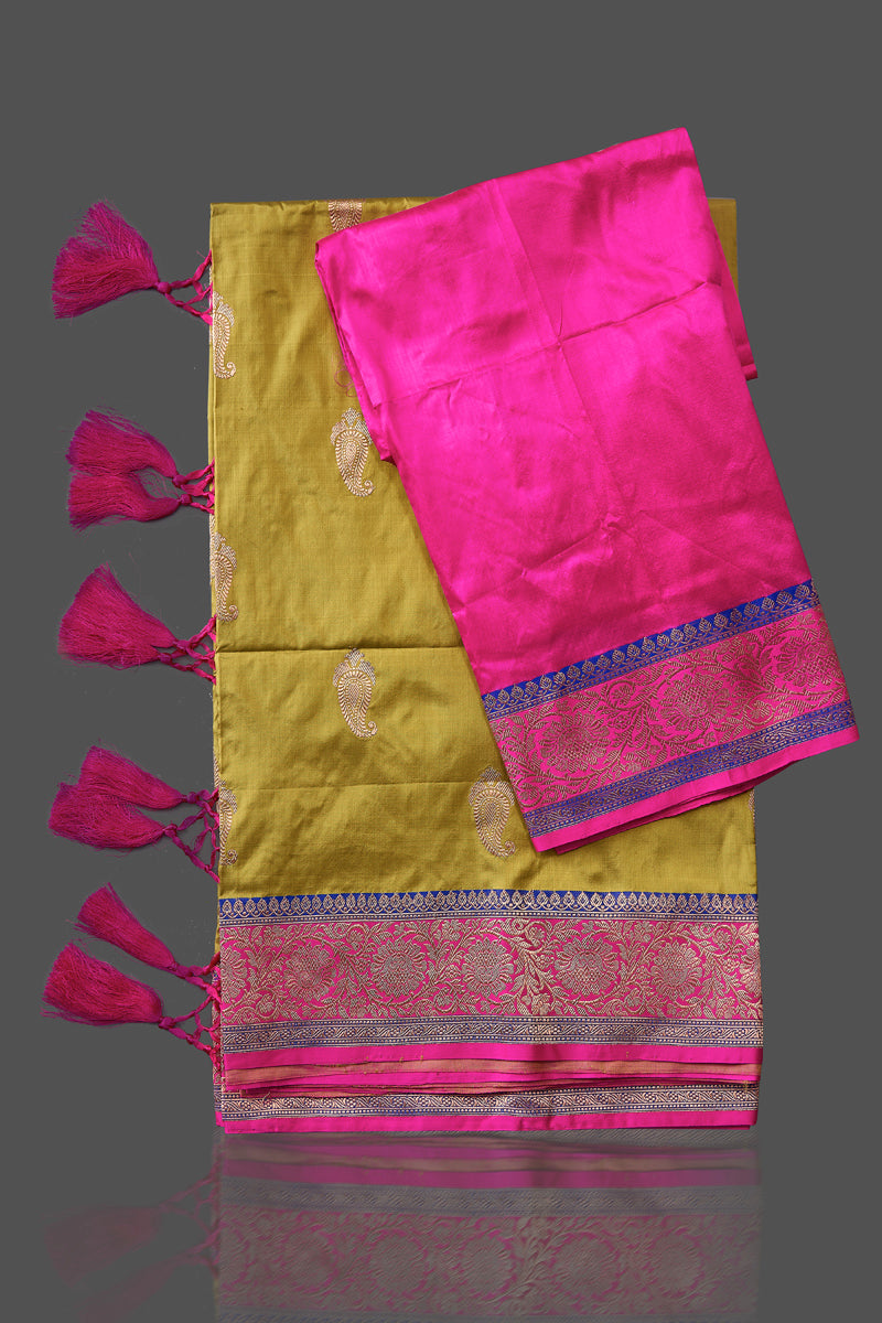 Shop beautiful yellow Banarasi silk sari in USA with zari pink border. Shop beautiful Banarasi georgette sarees, tussar saris, pure muga silk saris in USA from Pure Elegance Indian fashion boutique in USA. Get spoiled for choices with a splendid variety of Indian sarees to choose from! Shop now.-details