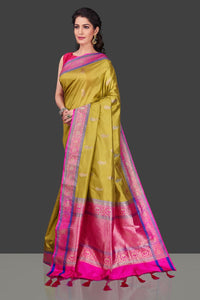 Shop beautiful yellow Banarasi silk sari in USA with zari pink border. Shop beautiful Banarasi georgette sarees, tussar saris, pure muga silk saris in USA from Pure Elegance Indian fashion boutique in USA. Get spoiled for choices with a splendid variety of Indian sarees to choose from! Shop now.-full view