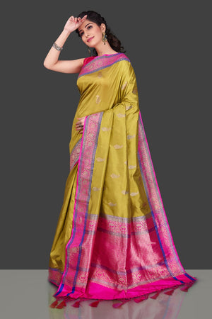 Shop beautiful yellow Banarasi silk sari in USA with zari pink border. Shop beautiful Banarasi georgette sarees, tussar saris, pure muga silk saris in USA from Pure Elegance Indian fashion boutique in USA. Get spoiled for choices with a splendid variety of Indian sarees to choose from! Shop now.-side