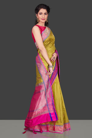Shop beautiful yellow Banarasi silk sari in USA with zari pink border. Shop beautiful Banarasi georgette sarees, tussar saris, pure muga silk saris in USA from Pure Elegance Indian fashion boutique in USA. Get spoiled for choices with a splendid variety of Indian sarees to choose from! Shop now.-right
