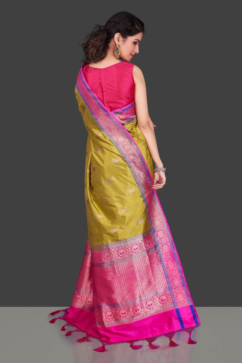 Shop beautiful yellow Banarasi silk sari in USA with zari pink border. Shop beautiful Banarasi georgette sarees, tussar saris, pure muga silk saris in USA from Pure Elegance Indian fashion boutique in USA. Get spoiled for choices with a splendid variety of Indian sarees to choose from! Shop now.-back
