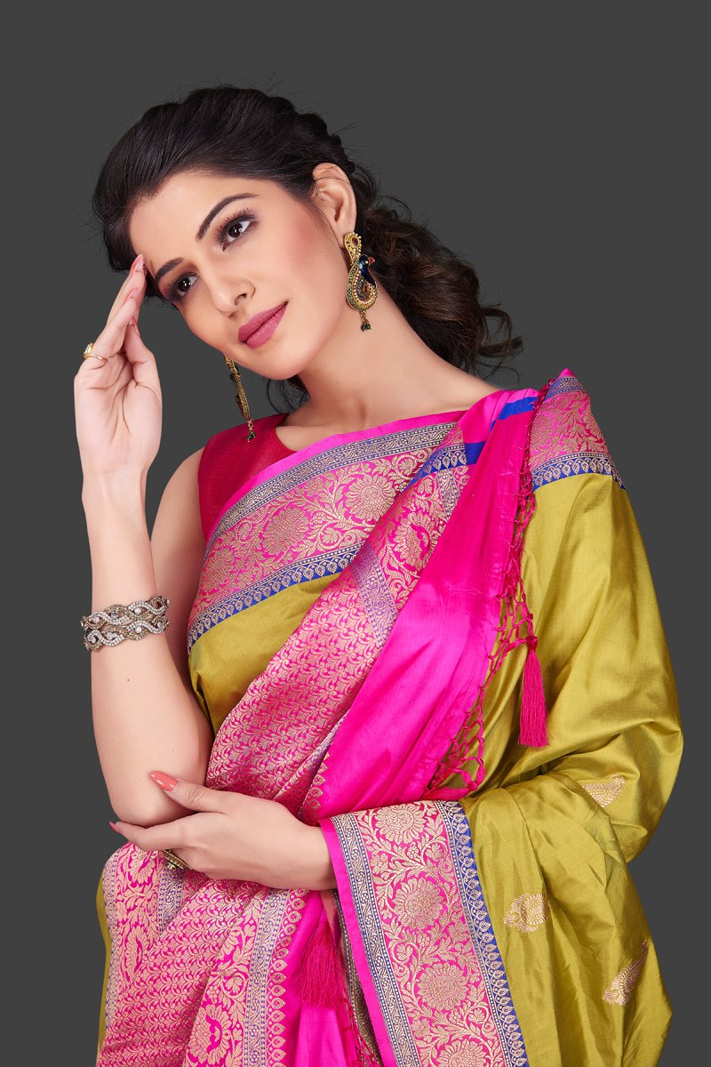 Shop beautiful yellow Banarasi silk sari in USA with zari pink border. Shop beautiful Banarasi georgette sarees, tussar saris, pure muga silk saris in USA from Pure Elegance Indian fashion boutique in USA. Get spoiled for choices with a splendid variety of Indian sarees to choose from! Shop now.-closeup