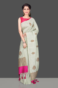 Shop beautiful mint green muga Banarasi saree in USA with zari floral buta. Shop beautiful Banarasi georgette sarees, tussar saris, pure muga silk saris in USA from Pure Elegance Indian fashion boutique in USA. Get spoiled for choices with a splendid variety of Indian sarees to choose from! Shop now.-full view