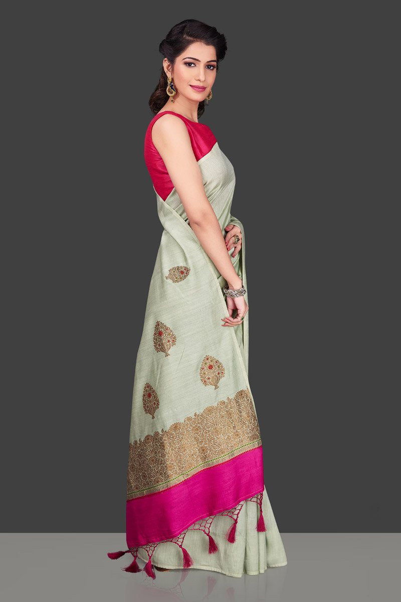 Shop beautiful mint green muga Banarasi saree in USA with zari floral buta. Shop beautiful Banarasi georgette sarees, tussar saris, pure muga silk saris in USA from Pure Elegance Indian fashion boutique in USA. Get spoiled for choices with a splendid variety of Indian sarees to choose from! Shop now.-right side