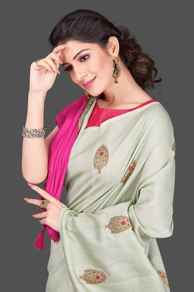 Shop beautiful mint green muga Banarasi saree in USA with zari floral buta. Shop beautiful Banarasi georgette sarees, tussar saris, pure muga silk saris in USA from Pure Elegance Indian fashion boutique in USA. Get spoiled for choices with a splendid variety of Indian sarees to choose from! Shop now.-closeup