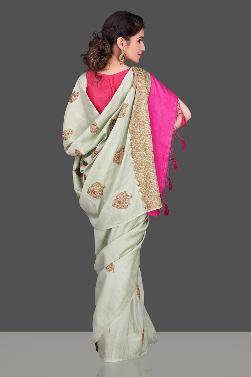 Shop beautiful mint green muga Banarasi saree in USA with zari floral buta. Shop beautiful Banarasi georgette sarees, tussar saris, pure muga silk saris in USA from Pure Elegance Indian fashion boutique in USA. Get spoiled for choices with a splendid variety of Indian sarees to choose from! Shop now.-back