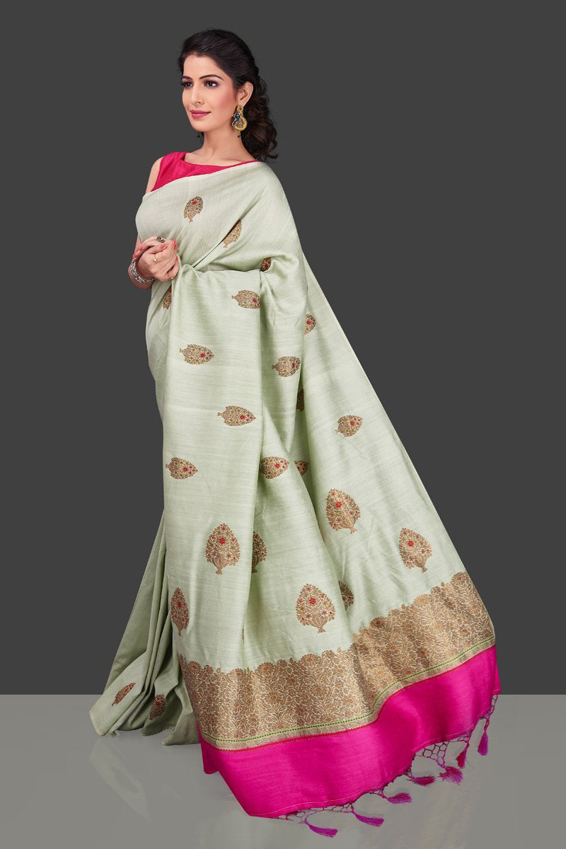 Shop beautiful mint green muga Banarasi saree in USA with zari floral buta. Shop beautiful Banarasi georgette sarees, tussar saris, pure muga silk saris in USA from Pure Elegance Indian fashion boutique in USA. Get spoiled for choices with a splendid variety of Indian sarees to choose from! Shop now.-left