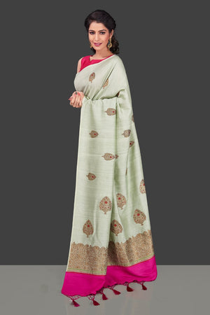Shop beautiful mint green muga Banarasi saree in USA with zari floral buta. Shop beautiful Banarasi georgette sarees, tussar saris, pure muga silk saris in USA from Pure Elegance Indian fashion boutique in USA. Get spoiled for choices with a splendid variety of Indian sarees to choose from! Shop now.-side
