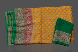 Shop online yellow georgette Benarasi saree in USA with pink green zari border. Shop beautiful Banarasi georgette sarees, tussar saris, pure muga silk saris in USA from Pure Elegance Indian fashion boutique in USA. Get spoiled for choices with a splendid variety of Indian sarees to choose from! Shop now.-details