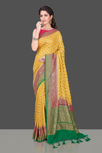 Shop online yellow georgette Benarasi saree in USA with pink green zari border. Shop beautiful Banarasi georgette sarees, tussar saris, pure muga silk saris in USA from Pure Elegance Indian fashion boutique in USA. Get spoiled for choices with a splendid variety of Indian sarees to choose from! Shop now.-full view