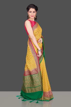 Shop online yellow georgette Benarasi saree in USA with pink green zari border. Shop beautiful Banarasi georgette sarees, tussar saris, pure muga silk saris in USA from Pure Elegance Indian fashion boutique in USA. Get spoiled for choices with a splendid variety of Indian sarees to choose from! Shop now.-side