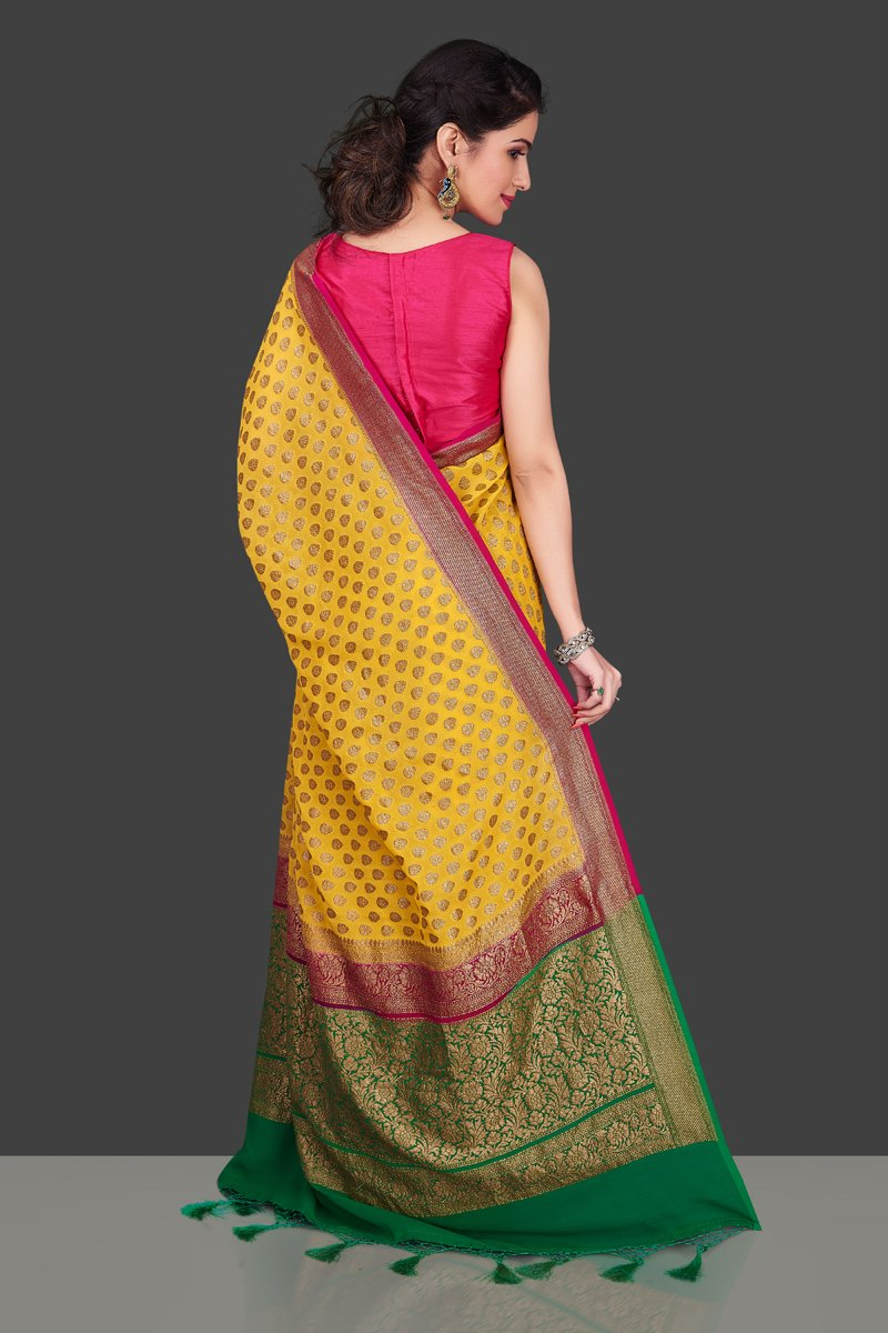 Shop online yellow georgette Benarasi saree in USA with pink green zari border. Shop beautiful Banarasi georgette sarees, tussar saris, pure muga silk saris in USA from Pure Elegance Indian fashion boutique in USA. Get spoiled for choices with a splendid variety of Indian sarees to choose from! Shop now.-back
