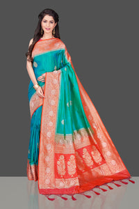 Shop blue green Benarasi silk saree online in USA with red zari border. Shop beautiful Banarasi georgette sarees, tussar saris, pure muga silk saris in USA from Pure Elegance Indian fashion boutique in USA. Get spoiled for choices with a splendid variety of Indian sarees to choose from! Shop now.-full view