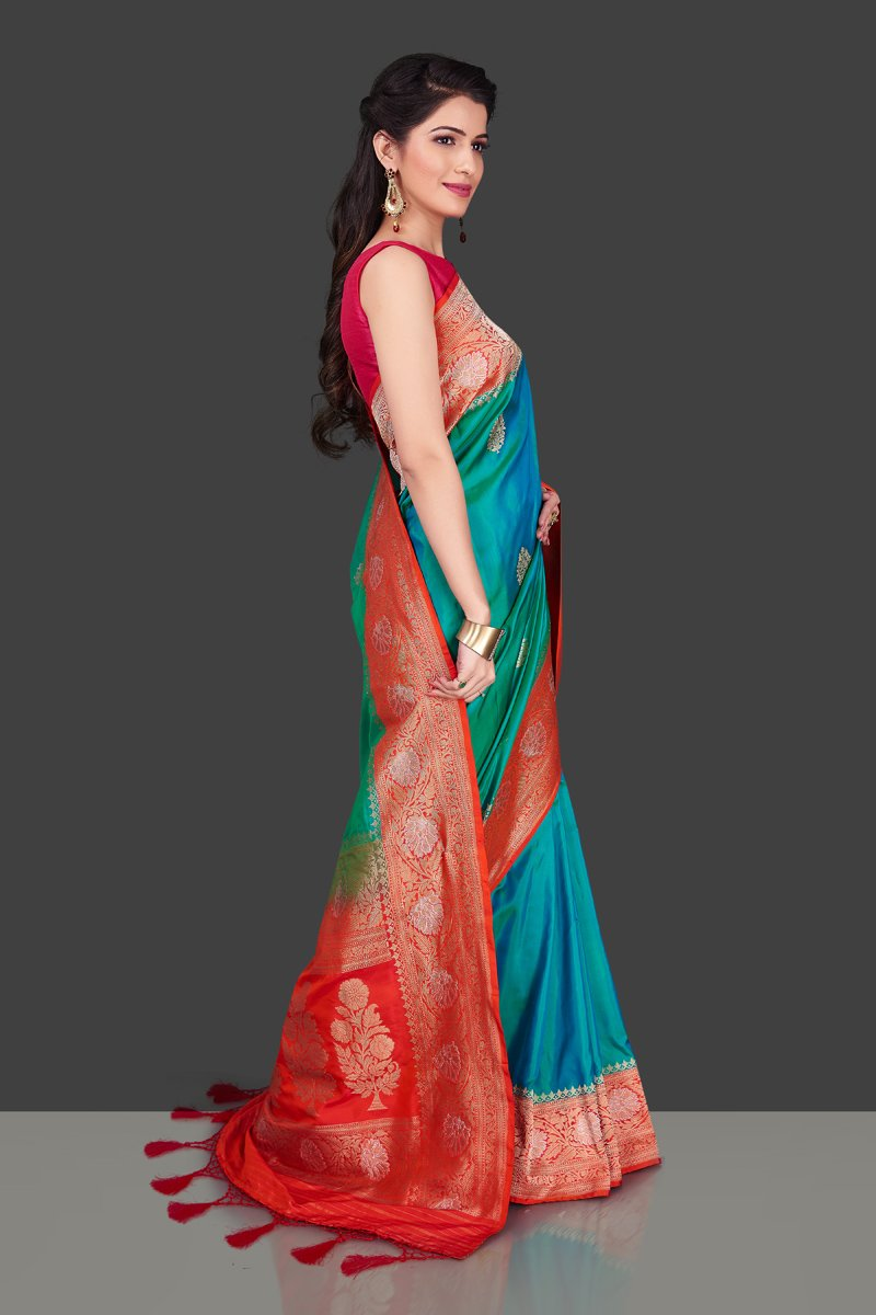 Shop blue green Benarasi silk saree online in USA with red zari border. Shop beautiful Banarasi georgette sarees, tussar saris, pure muga silk saris in USA from Pure Elegance Indian fashion boutique in USA. Get spoiled for choices with a splendid variety of Indian sarees to choose from! Shop now.-side