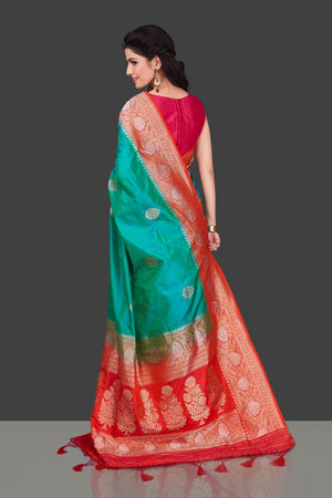 Shop blue green Benarasi silk saree online in USA with red zari border. Shop beautiful Banarasi georgette sarees, tussar saris, pure muga silk saris in USA from Pure Elegance Indian fashion boutique in USA. Get spoiled for choices with a splendid variety of Indian sarees to choose from! Shop now.-back