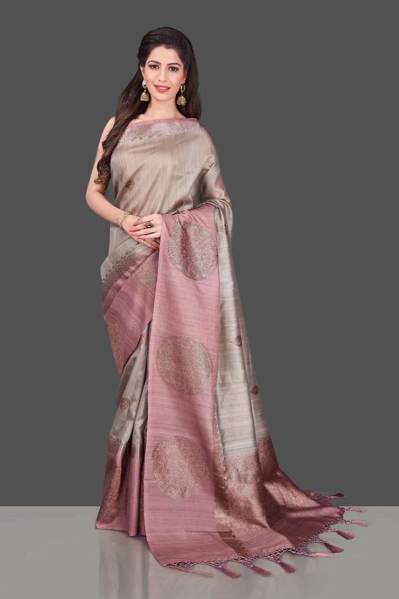 Shop grey tassar Benarasi saree online in USA with zari buta on mauve border. Shop beautiful Banarasi georgette sarees, tussar saris, pure muga silk saris in USA from Pure Elegance Indian fashion boutique in USA. Get spoiled for choices with a splendid variety of Indian sarees to choose from! Shop now.-full view