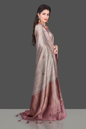 Shop grey tassar Benarasi saree online in USA with zari buta on mauve border. Shop beautiful Banarasi georgette sarees, tussar saris, pure muga silk saris in USA from Pure Elegance Indian fashion boutique in USA. Get spoiled for choices with a splendid variety of Indian sarees to choose from! Shop now.-side